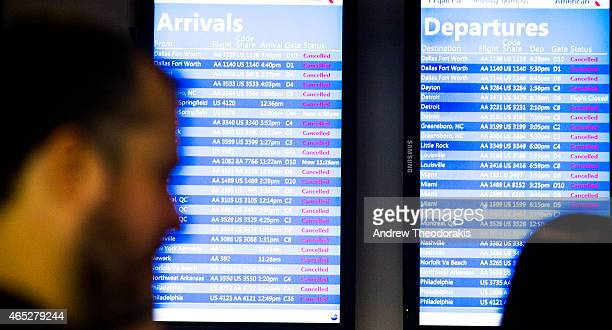 Departure and arrival boards show cancelled flights March 5 2015 at LaGuardia Airport in the Queens borough of New York City A Delta jet partially...