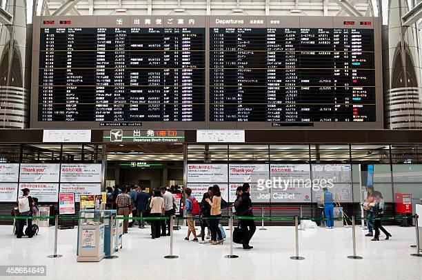 departure board and passengers at narita airport - narita international airport stock photos and pictures