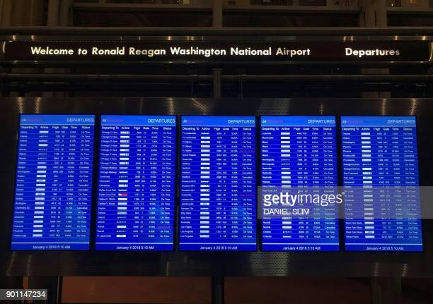 A departure board at Ronald Reagan airport near Washington DC posts several cancelled flights early January 4 2018 as winter storm Grayson sets in on...