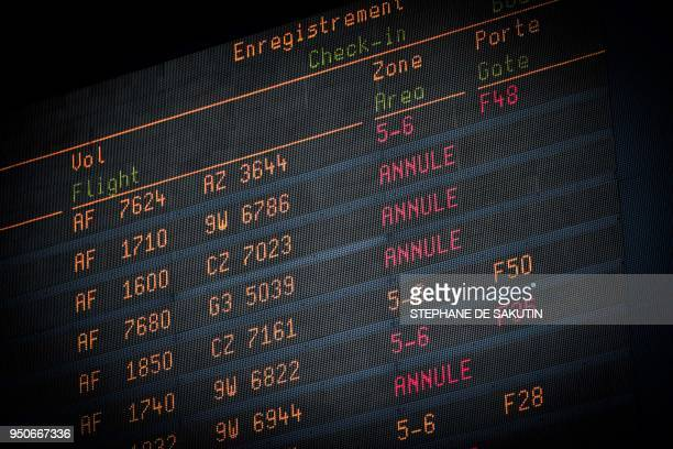 A departure board at the RoissyCharles de Gaulle airport near Paris announces canceled flight on April 24 2018 as French airliner company Air France...