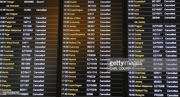 A departure board displays flight cancellations after heavy snow closed the runway cancelling flights at Gatwick Airport in southern England on...