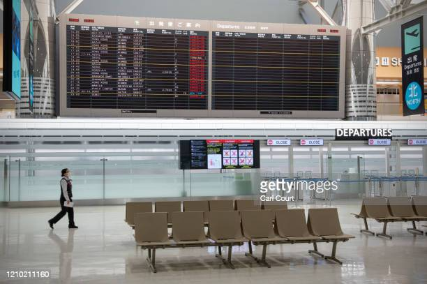 Departure board displays mainly cancelled flights at Narita Airport on April 17, 2020 in Tokyo, Japan. Narita Airport, one of Japans busiest, has...