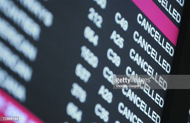 A departure board shows multiple 'cancelled' announcements at Denver International Airport on December 22 2006 in Denver Colorado Flights have been...