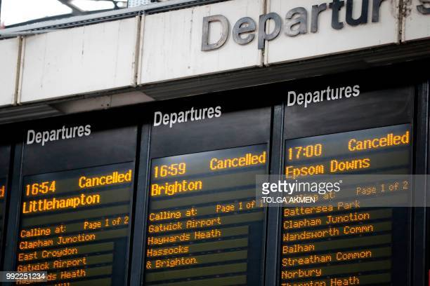 Departure boards at London's Victoria railway station display a list of cancelled trains on July 5 after an electrical supply problem in south London...
