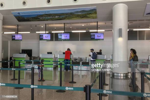 Departure desk is viewed at the V.C. Bird International Airport on June 13, 2019 in Saint John's, Antigua. - A Caribbean airline that helps bind...