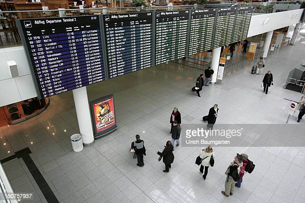 GERMANY MUNICH Departure hall terminal 2 with passengers and departure boards Franz Josef Strauss airport in Munich MuenchenErding