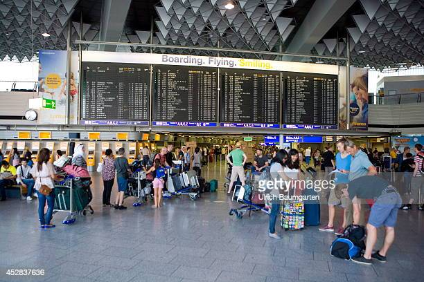 Departure hall with Lufthansa checkin counters at the Frankfurt Airport on July 25 2014 in Frankfurt Germany
