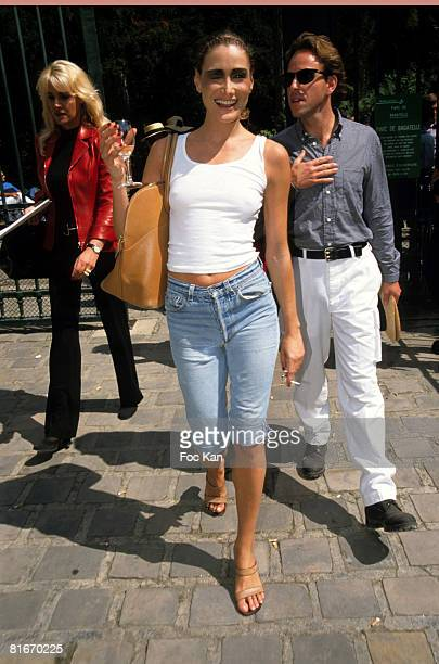 Departure of Carla Bruni from the Christian Dior High Fashion Show at the Garden of Bagatelle on July 131997 in Paris France