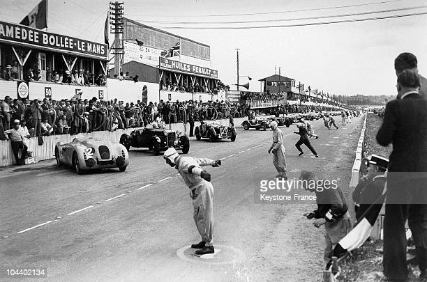 Departure of the automobile race 24 HEURES DU MANS in 1939 The racers are leaping onto the track to get to their cars This year it was the racer...