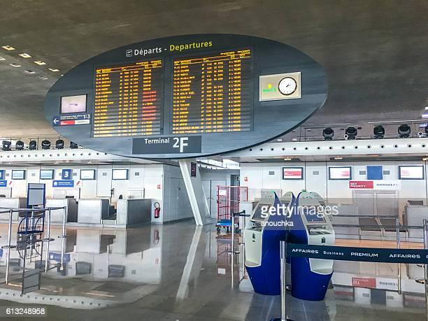 Departures board at Roissy Charle de Gaulle Airport, Paris