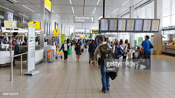 departures hall at schiphol airport - schiphol airport stock photos and pictures
