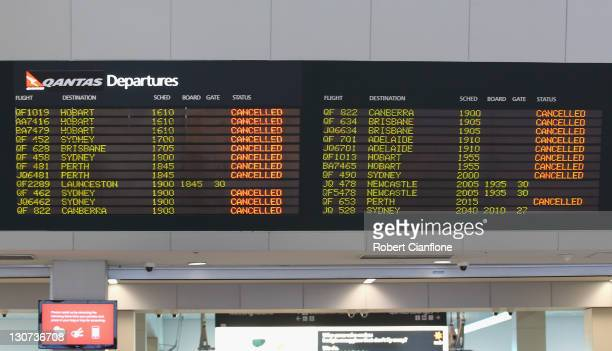 A departures screen shows all Qantas flights as cancelled on October 29 2011 in Melbourne Australia Qantas CEO Alan Joyce announced at a press...