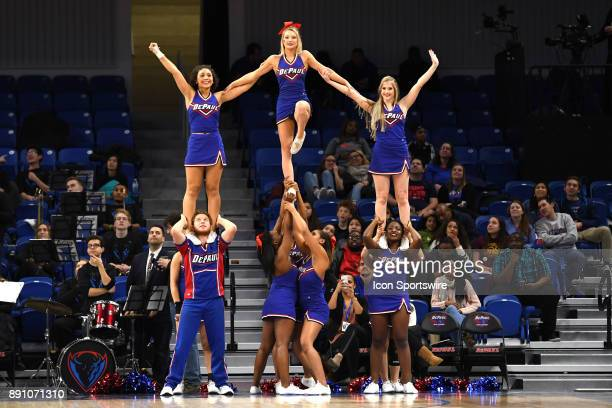 DePaul Blue Demons cheerleaders form a pyramid in the first half during a game between the Connecticut Huskies and the DePaul Blue Demons on December...