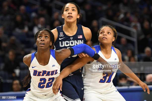 DePaul Blue Demons forward Chante Stonewall and DePaul Blue Demons guard Deja Cage blocks Connecticut Huskies forward Gabby Williams during a game...