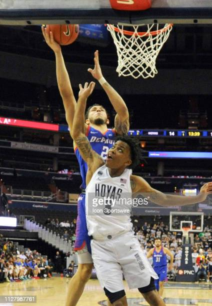 DePaul Blue Demons forward Jaylen Butz scores against Georgetown Hoyas guard James Akinjo on February 27 at the Capital One Arena in Washington DC