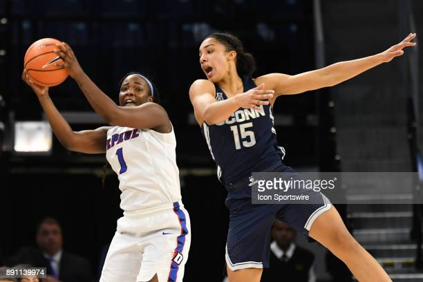 DePaul Blue Demons guard Ashton Millender controls the ball against Connecticut Huskies forward Gabby Williams during a game between the Connecticut...