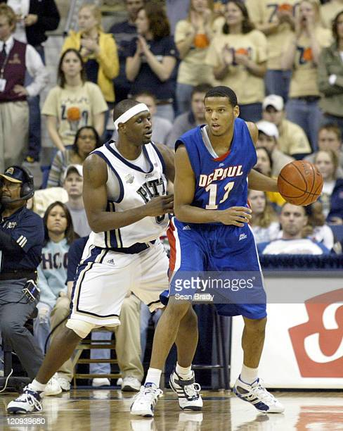 DePaul's Sammy Mejia is guarded by Pittsburgh Panthers John DeGroat during action at the Petersen Events Center on January 12, 2006 in Pittsburgh,...