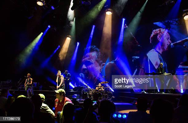 Depeche Mode performs during their tour opener in support of The Delta Machine Tour at the DTE Energy Music Theater on August 22 2013 in Clarkston...