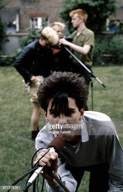 Depeche Mode pose with microphones, circa 1981. Dave Gahan is at the front, behind are Martin Gore, Vince Clark, Andrew Fletcher.