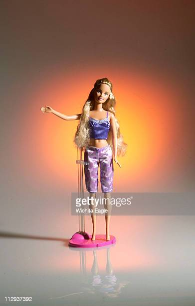 Depending on which source you believe if Barbie were human she's weigh 100 to 110 pounds and be 5feet9 tall