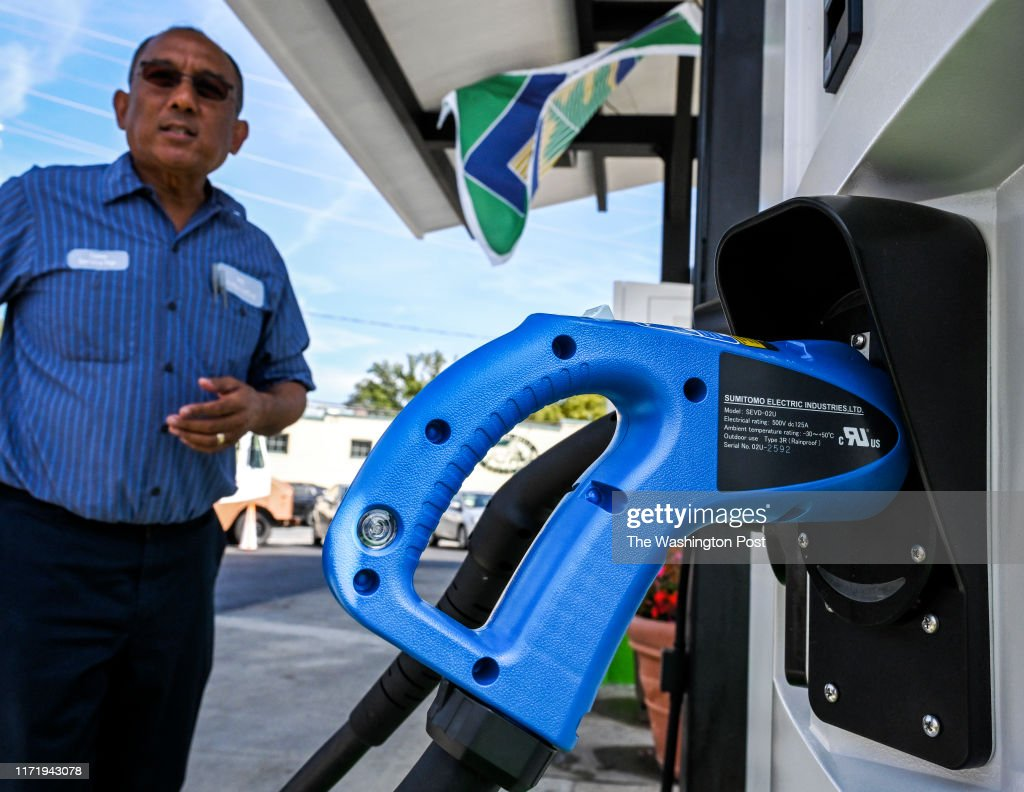 Depeswar Doley, owner of RS Automotive, has converted his gas pumps to electric vehicle charging stations. , on September 27 in Takoma Park, MD. : News Photo