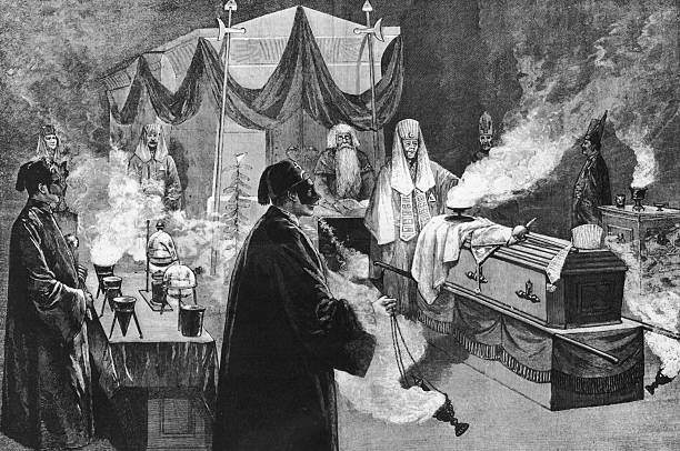 A depiction of a ritual taking place in a masonic lodge,...