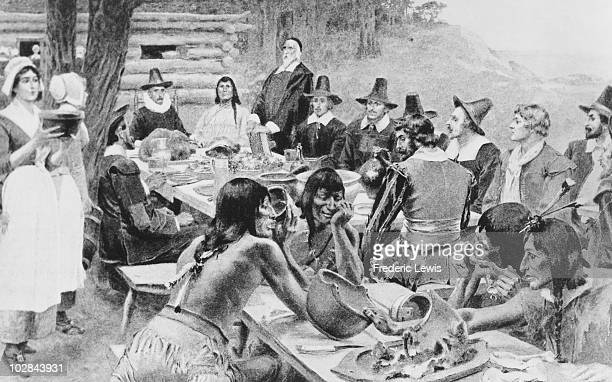 A depiction of early settlers of the Plymouth Colony sharing a harvest Thanksgiving meal with members of the local Wampanoag tribe at the Plymouth...