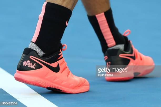 A depiction of Melbourne landmark Flinders Street Station is seen on the shoes of Roger Federer of Switzerland in his first round match against Aljaz...