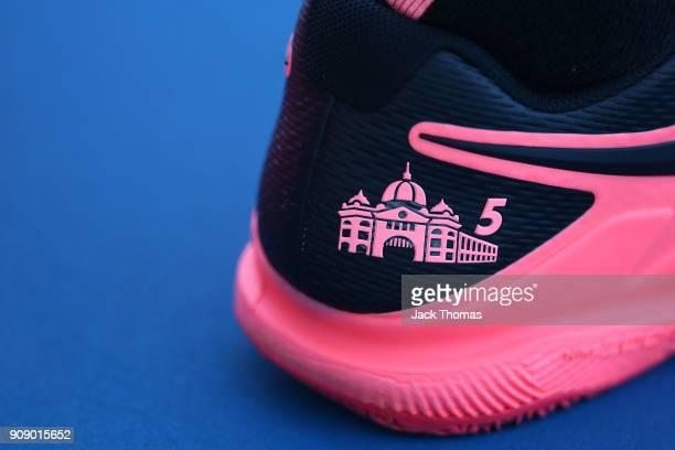 A depiction of Melbourne landmark Flinders Street Station is seen on the Nike shoes of Roger Federer of Switzerland on day nine of the 2018...