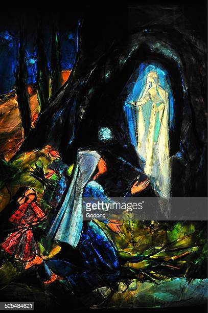 Depiction of the first Marian apparition of our Lady of Lourdes to Bernadette Soubirous in the french city of Lourdes The first apparition occured on...