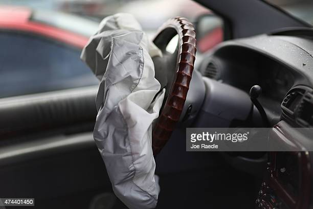 A deployed airbag is seen in a Chrysler vehicle at the LKQ Pick Your Part salvage yard on May 22 2015 in Medley Florida The largest automotive recall...