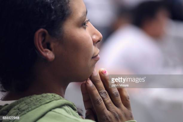 A deported Guatemalan immigrant waits to be processed at Guatemalan immigration after arriving on an ICE deportation flight on February 9 2017 to...