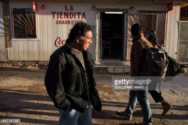 Deported migrant Luis Manuel Testa from Acapulco Mexico stands outside a grocery store where he works near the US/Mexico border line in the town of...