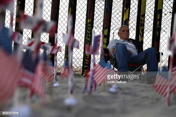 Deported US Army veteran Mario Rodriguez looks on during a Fourth of July gathering on the beach next to the USMexican border fence at Playas de...