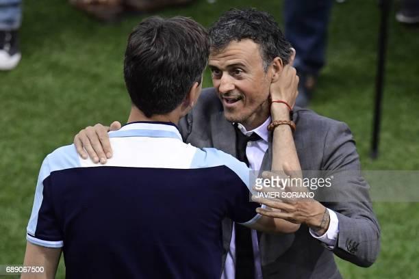 Deportivo Alaves' Argentinian coach Mauricio Pellegrino greets Barcelona's coach Luis Enrique before the Spanish Copa del Rey final football match FC...
