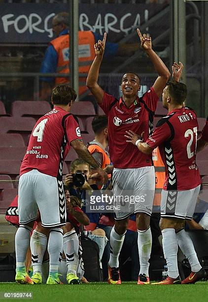 Deportivo Alaves' Brazilian forward Deyverson celebrates a goal with teammates during the Spanish league football match FC Barcelona vs Deportivo...
