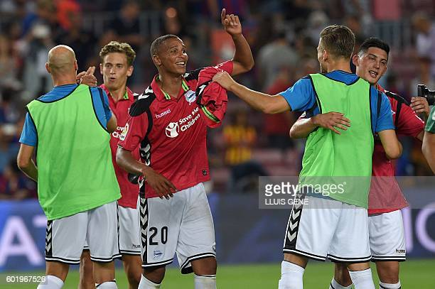 Deportivo Alaves' Brazilian forward Deyverson celebrates with teammates at the end of the Spanish league football match FC Barcelona vs Deportivo...