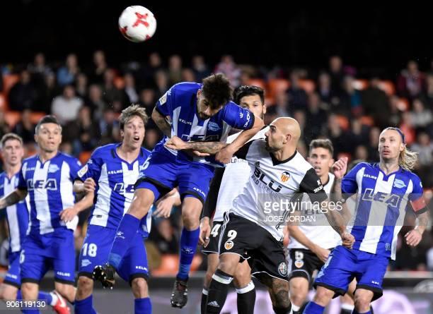 Deportivo Alaves' Chilean midfielder Guillermo Maripan vies with Valencia's Italian forward Simone Zaza during the Spanish 'Copa del Rey' football...