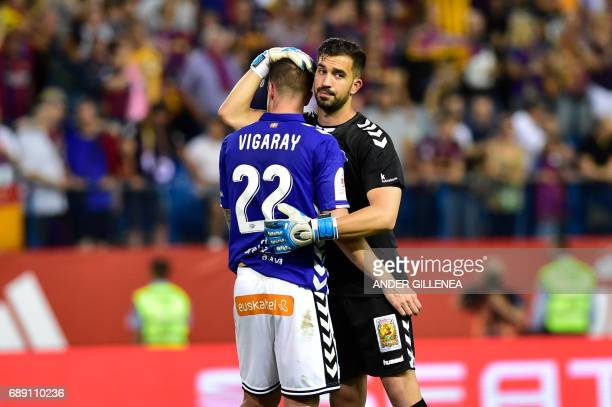 Deportivo Alaves' defender Carlos Vigaray is comforted by Deportivo Alaves' goalkeeper Fernando Pacheco at the end of the Spanish Copa del Rey final...