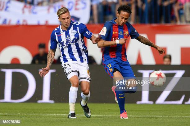 Deportivo Alaves' defender Kiko Femenia vies with Barcelona's Brazilian forward Neymar during the Spanish Copa del Rey final football match FC...