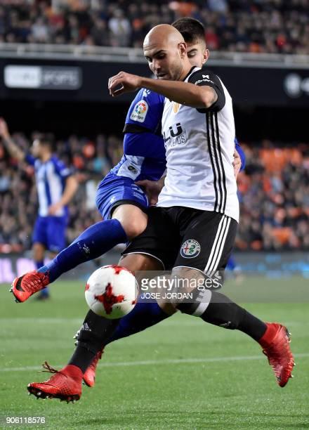 Deportivo Alaves' defender Martin vies with Valencia's Italian forward Simone Zaza during the Spanish 'Copa del Rey' football match between Valencia...