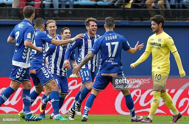 Deportivo Alaves' forward Ibai Gomez celebrates after scoring with teammates during the Spanish league football match Villarreal CF vs Deportivo...