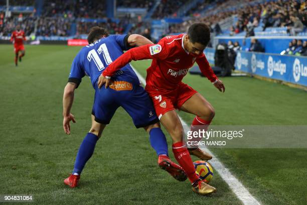 Deportivo Alaves' forward Ibai Gomez challenges Sevilla's French forward Ben Yedder during the Spanish league football match between Alaves and...