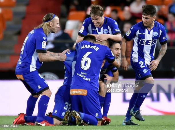 Deportivo Alaves' forward Ruben Sobrino celebrates a goal with teammates during the Spanish 'Copa del Rey' football match between Valencia CF and...
