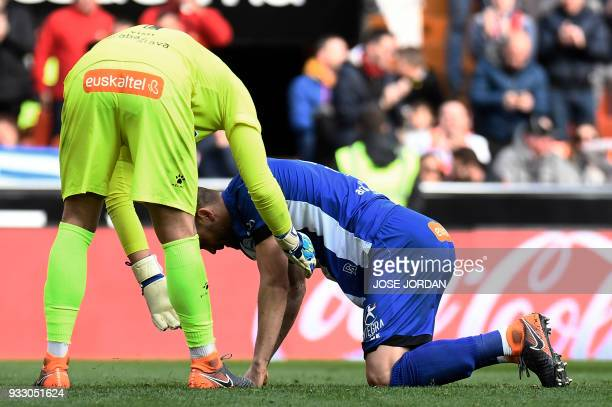 Deportivo Alaves' goalkeeper Fernando Pacheco comforts Deportivo Alaves' defender Victor Laguardia after scoring an own goal during the Spanish...