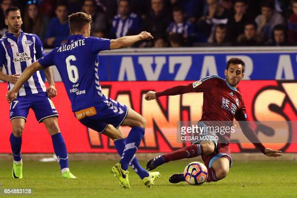 Deportivo Alaves' midfielder Marcos Llorente vies with Real Sociedad's forward Juanmi during the Spanish league football match Deportivo Alaves vs...