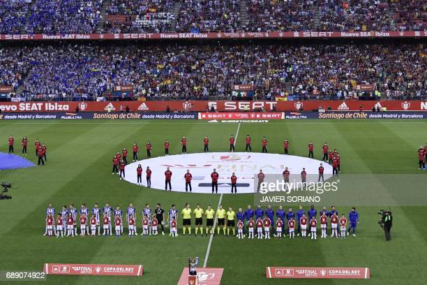 Deportivo Alaves players and Barcelona players pose before the Spanish Copa del Rey final football match FC Barcelona vs Deportivo Alaves at the...