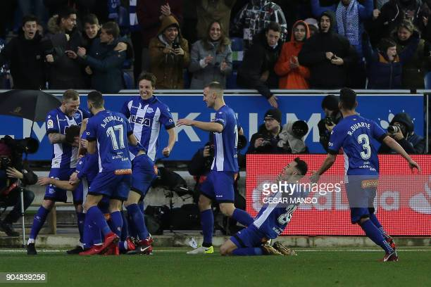 Deportivo Alaves' players celebrate after scoring a goal during the Spanish league football match between Alaves and Sevilla at the Mendizorrotza...