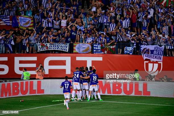 Deportivo Alaves' players celebrate after scoring the equalizer during the Spanish Copa del Rey final football match FC Barcelona vs Deportivo Alaves...