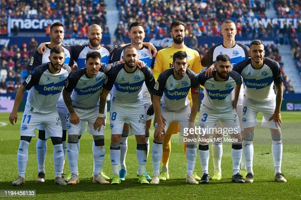 Deportivo Alaves players line up prior to the Liga match between Levante UD and Deportivo Alaves at Ciutat de Valencia on January 18, 2020 in...